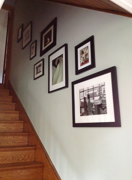 Staircase Wall with Black and White Photographs.