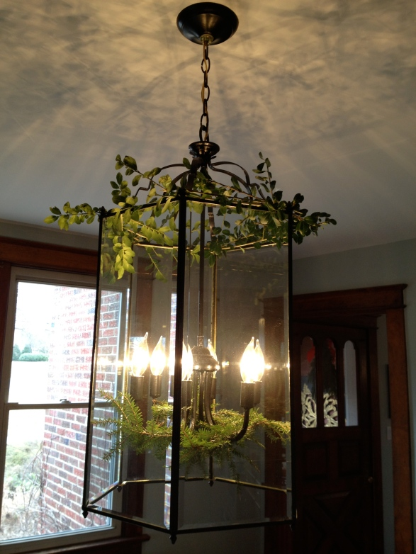 Chandelier with greenery.