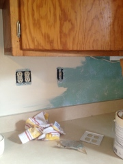 Getting rid of the faux-paint backsplash.
