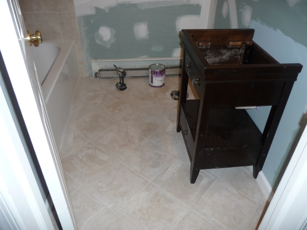 Greenboard on the walls, a new vanity and grout.