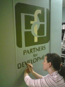 Painting the PFD logo on the wall.