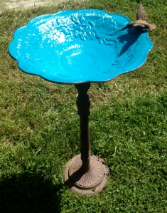 Spray-painted birdbath.